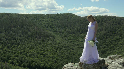 bride holding flowers on the background of Mountain View Footage