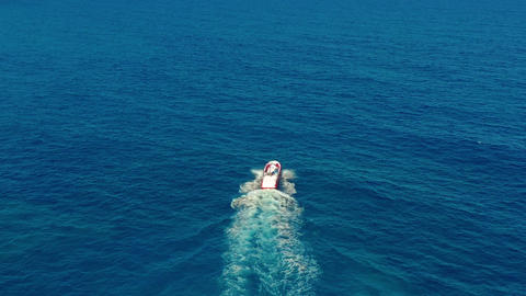 Aerial view. Boat moves on the sea. One boat in the blue sea. Concept travel and Live Action