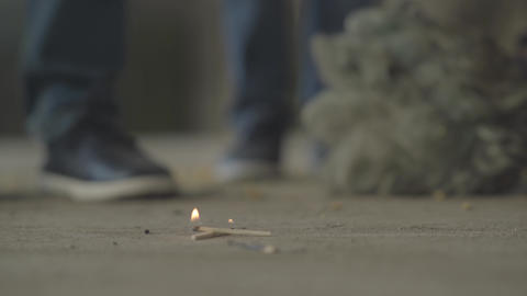 Two unrecognized boys playing with the matches in abandoned building. The Live Action