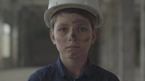 Portrait handsome boy in a protective helmet looking at the camera in the Live Action