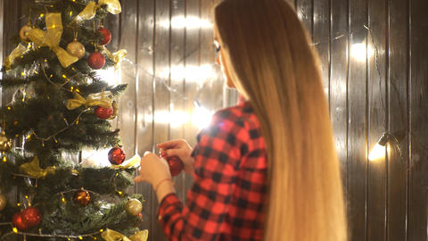 Beautiful Young Woman Decorating A Christmas Tree For The Celebration Of Live Action