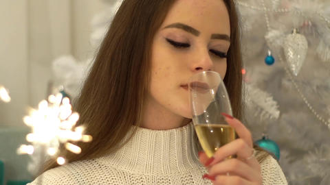 Woman Celebrating Christmas Holding Champagne And Sparklers Live Action