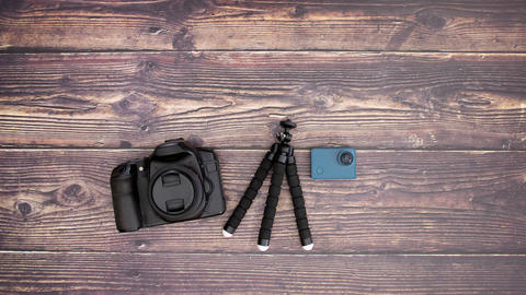 Photography equipment appearing on wooden background - Stop motion Animation