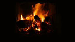 Fire burning in fireplace. Fireplace full of fire wood and fire Footage
