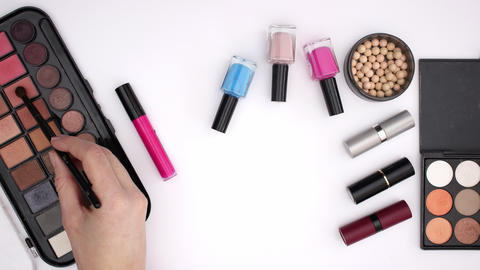 Woman's hand take with brush eye shadow and picking lipstick - Stop motion Animation