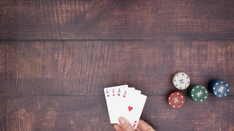 Woman's hand put four aces on the table and pick up chips - Stop motion Animation