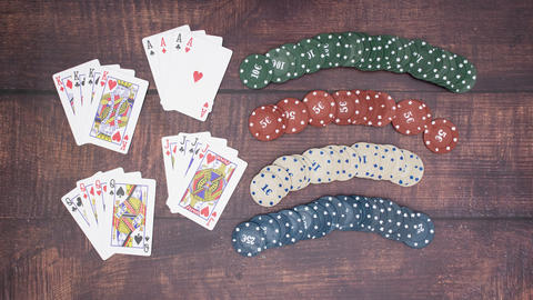 Deck of cards and poker chips on wooden background - Stop motion Animation