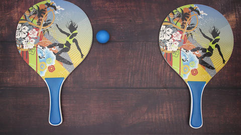 Rackets for beach games and ball playing on wooden background - Stop motion Animation