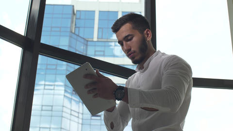 Businessman working on tablet PC Live Action