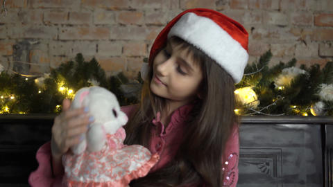Best Christmas Toy. Little Girl With Cute Bunny At Christmas Tree. Small Girl Live Action