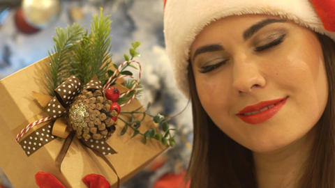 Beautiful Girl In Santa Hat Gives A Gift, Fullhd Live Action