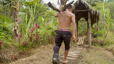 Indigenous Man With An Injured Foot Carrying Wooden Sticks Live Action