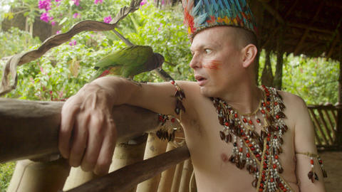 Tribal Funny Man With Parrot In Ecuador Live Action