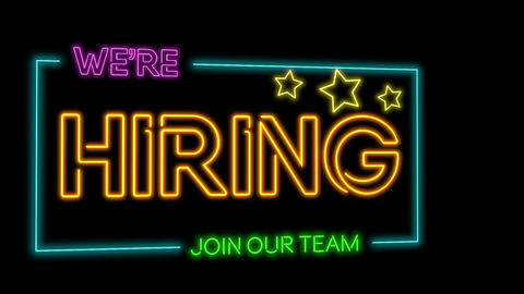Rotating Multicoloured neon sign of the word 'We're hiring - join the team' flickering neon lights Animation