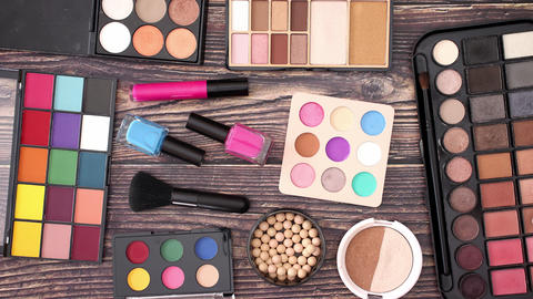 Make up and cosmetics products disappearing from wooden background - Stop motion Animation
