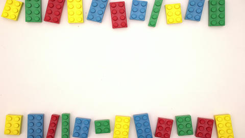 Colorful bricks on white background - Stop motion Animation