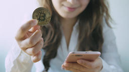 Bitcoin Over Woman Using Mobile Phone Background Live影片