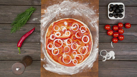 Top view of vegetarian pizza on wooden plate on the table, stop motion animation Footage