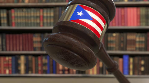 Flag of Puerto Rico on falling judges gavel in court. National justice or Live Action