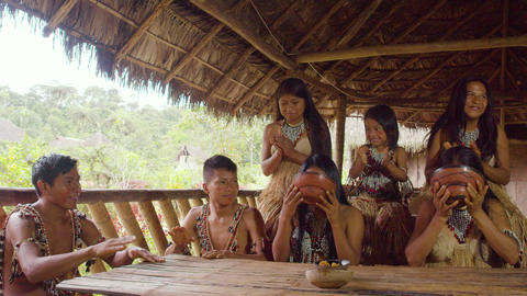 Indigenous Family Competing In Drinking Fermented Yucca Chicha Drink In Ecuador Footage