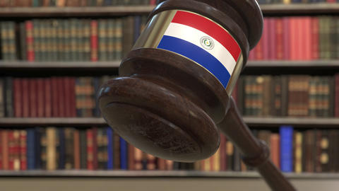 Flag of Paraguay on falling judges gavel in court. National justice or Live Action