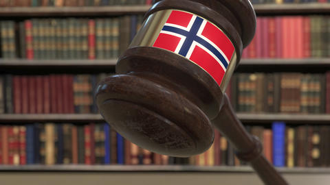 Flag of Norway on falling judges gavel in court. National justice or Live Action