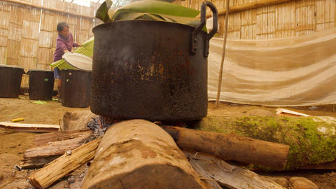 Indigenous Old Woman Cooking In A Primitive Kitchen In The Amazon Rainforest In Ecuador Live Action