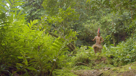 Indigenous Warrior Running Through The Amazon Rainforest In Ecuador Footage