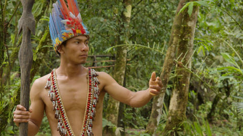 Indigenous Warrior Showing The Viewer The Amazon Rainforest In Ecuador Footage