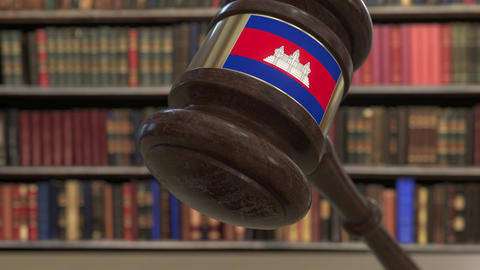 Flag of Cambodia on falling judges gavel in court. National justice or Live Action