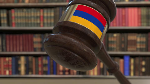 Flag of Armenia on falling judges gavel in court. National justice or Live Action