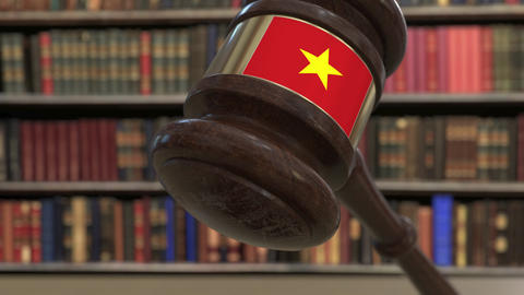 Flag of Vietnam on falling judges gavel in court. National justice or Live Action