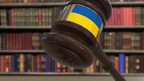 Flag of Ukraine on falling judges gavel in court. National justice or Live Action