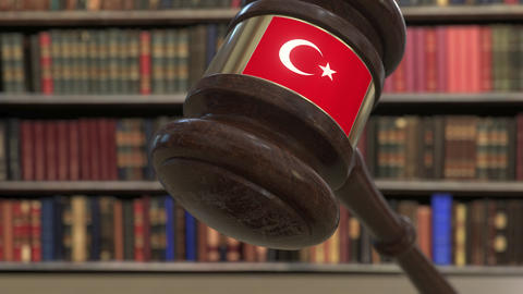 Flag of Turkey on falling judges gavel in court. National justice or Live Action