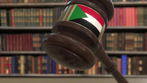 Flag of Sudan on falling judges gavel in court. National justice or jurisdiction Live Action