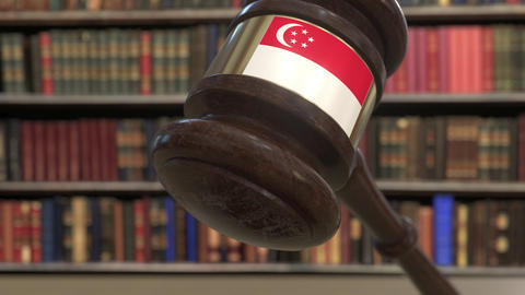 Flag of Singapore on falling judges gavel in court. National justice or Live Action