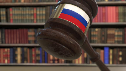 Flag of Russia on falling judges gavel in court. National justice or Live Action