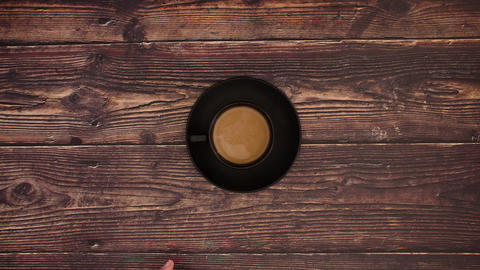 Cup of Coffee on wooden background - Stop motion animation Animation