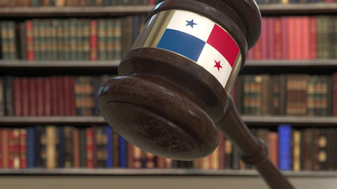 Flag of Panama on falling judges gavel in court. National justice or Live Action