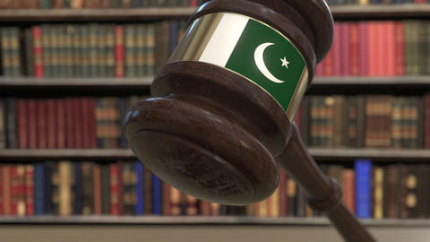 Flag of Pakistan on falling judges gavel in court. National justice or Live Action