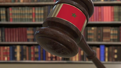 Flag of Morocco on falling judges gavel in court. National justice or Live Action
