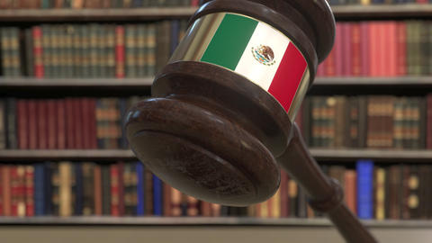 Flag of Mexico on falling judges gavel in court. National justice or Live Action