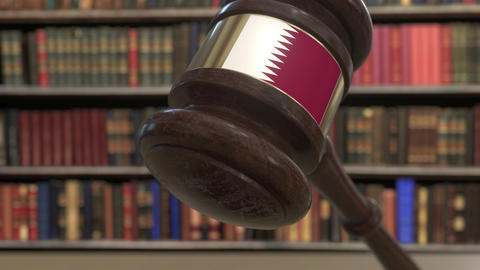 Flag of Qatar on falling judges gavel in court. National justice or jurisdiction Live Action
