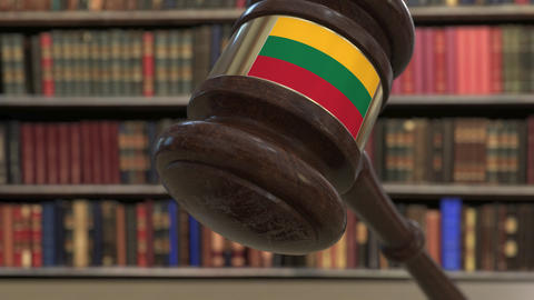 Flag of Lithuania on falling judges gavel in court. National justice or Live Action