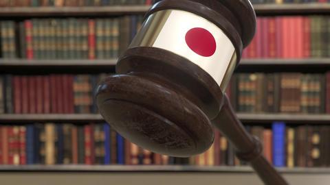 Flag of Japan on falling judges gavel in court. National justice or jurisdiction Live Action