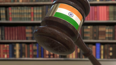Flag of India on falling judges gavel in court. National justice or jurisdiction Live Action