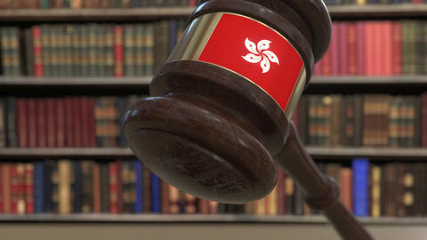 Flag of Hong Kong on falling judges gavel in court. National justice or Live Action