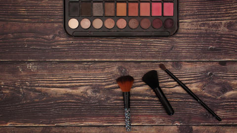 Eye Shadow and brushes on wooden background - Stop motion animation Animation