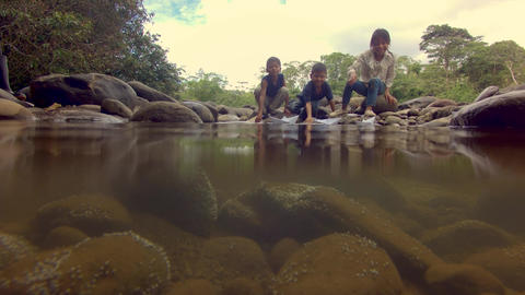 Indigenous Kids Playing With Paper Boats On The River In The Amazon Rainforest Footage