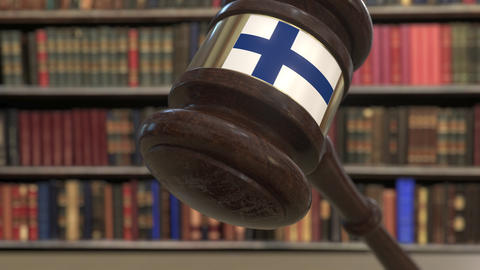 Flag of Finland on falling judges gavel in court. National justice or Live Action